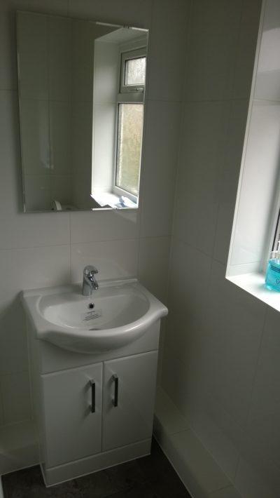 mirror, sink, cabinet
