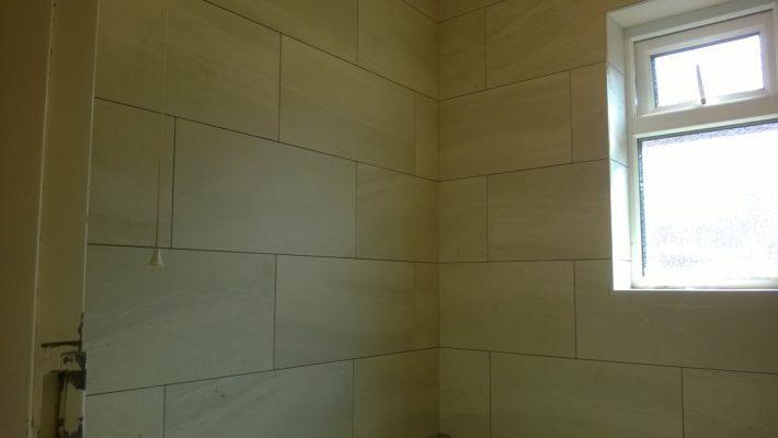 large bathroom tiles, not finished
