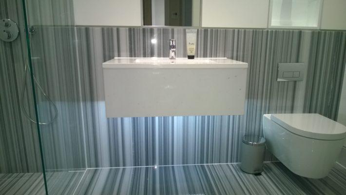 large bathroom tiles, floating sink