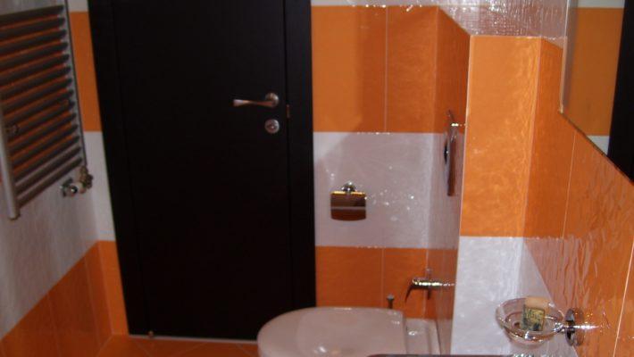 white & orange tiled bathroom